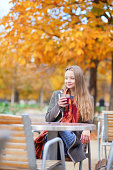 istock Smiling young lady drinking mulled wine 178503086
