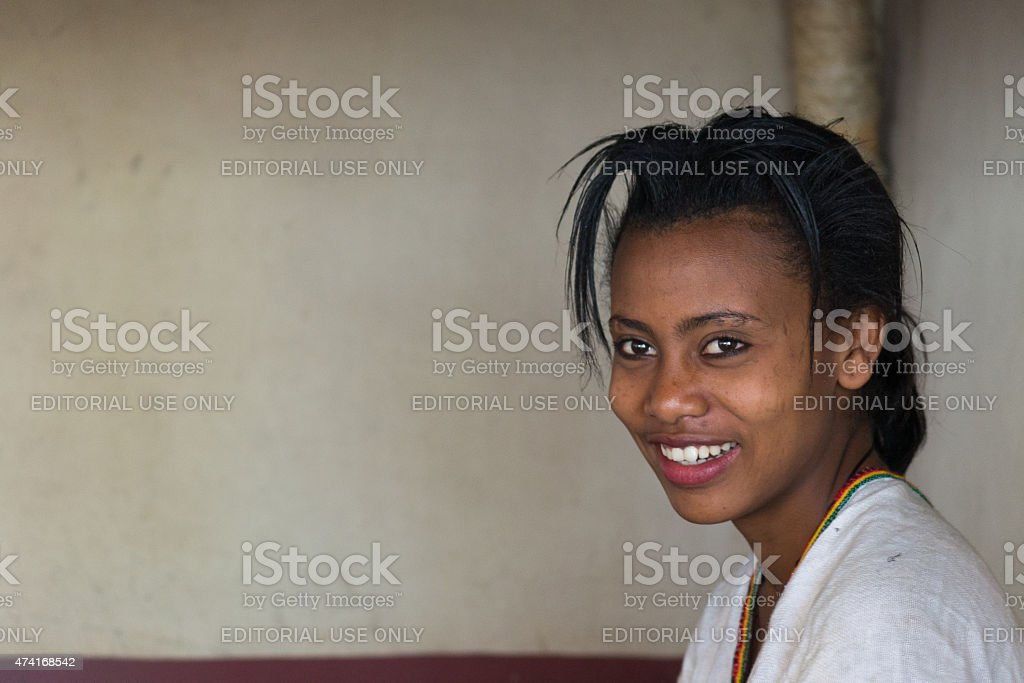 Portrait of a smiling young woman of ethiopian ethnicity in Bahir...