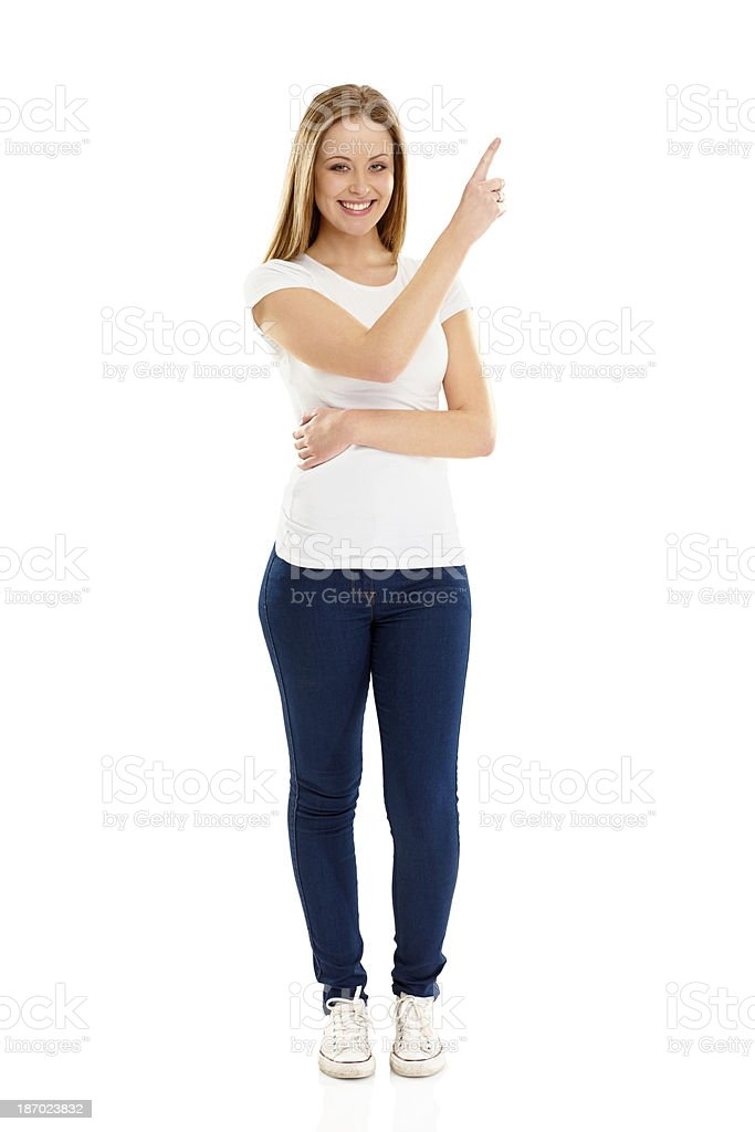 Smiling young lady showing copyspace for advertisement royalty-free stock photo