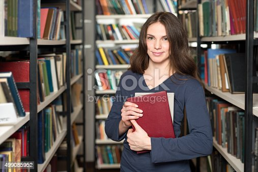 istock smiling young lady with loose long dark hair 499085952