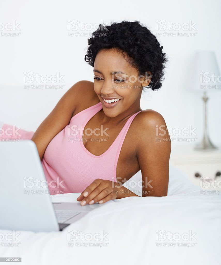 Smiling young lady working on laptop royalty-free stock photo