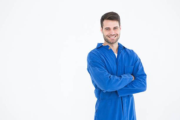 machanic souriant jeune homme debout Bras croisés - Photo