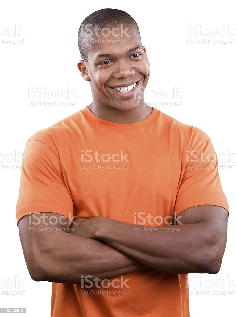 Smiling young male with arms crossed stock photo
