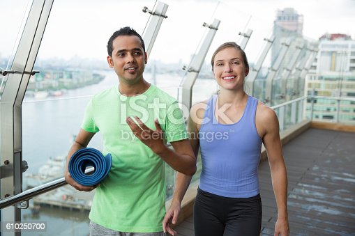 istock Smiling young man and woman chatting after sports 610250700