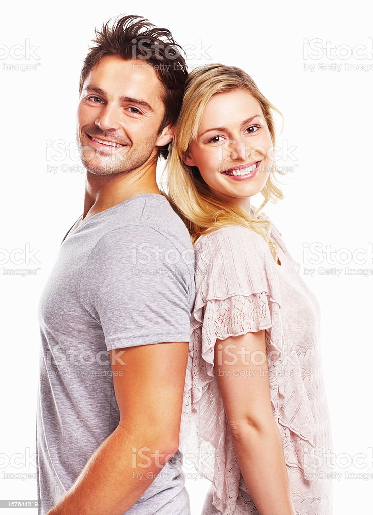 Smiling young man and woman standing against white stock photo