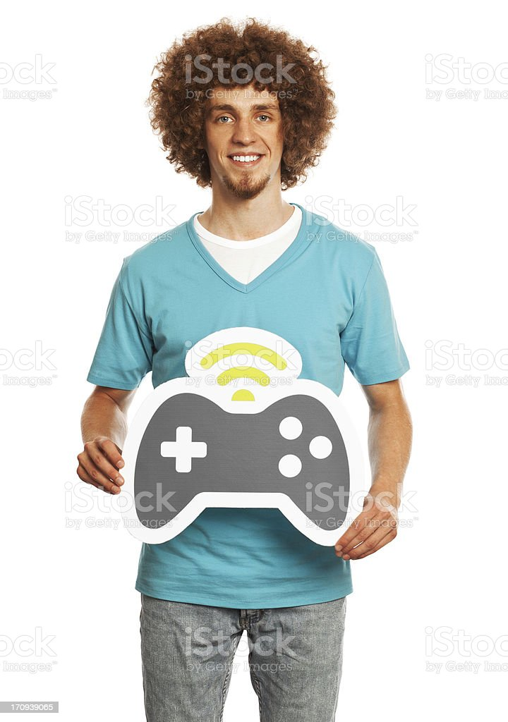 Smiling young man holding gamepad sign isolated on white background. royalty-free stock photo