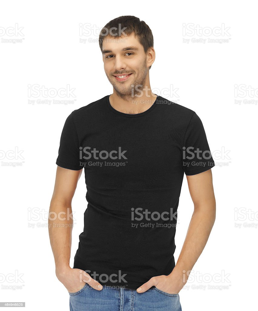 smiling young man in blank black t-shirt stock photo
