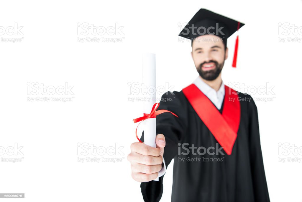 Smiling Young Man In Graduation Gown Holding Certificate Stock Photo ...
