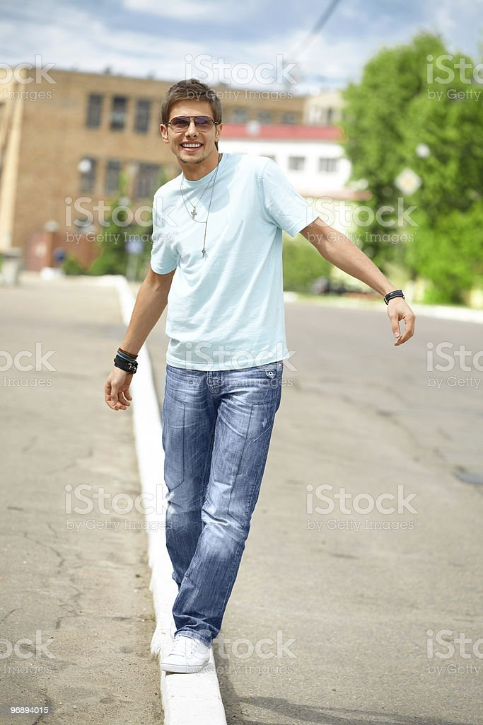 Smiling young man on the city street royalty-free stock photo