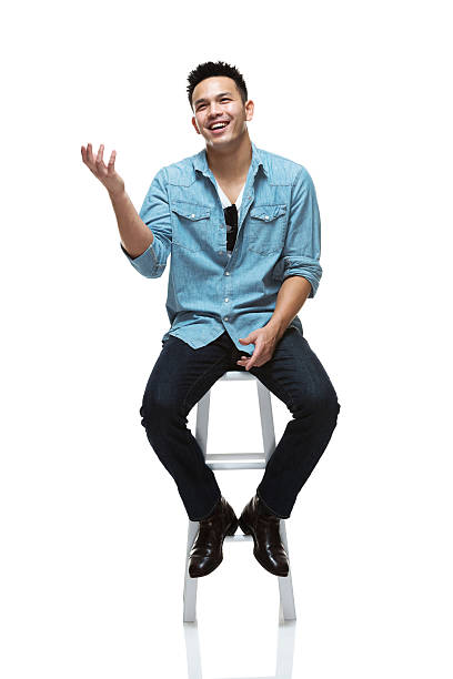 Smiling young man Smiling young manhttp://www.twodozendesign.info/i/1.png stool stock pictures, royalty-free photos & images