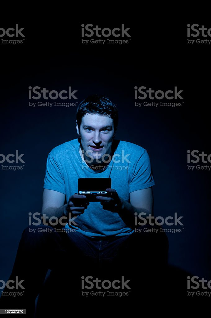 Smiling Young Man Playing Video Game royalty-free stock photo