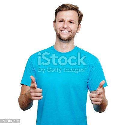 1018069806 istock photo Smiling young man pointing at camera 492581426
