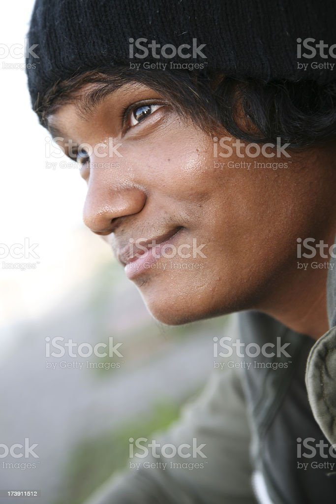 Smiling Young Man Sitting on a Curb royalty-free stock photo