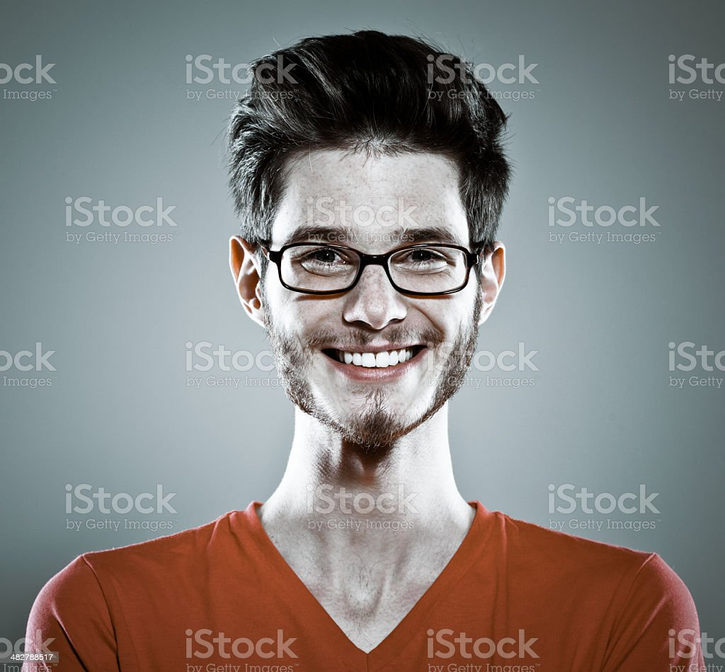 Smiling young man, Studio Portrait Portrait of smiling young man against grey background. Studio shot. 20-29 Years Stock Photo