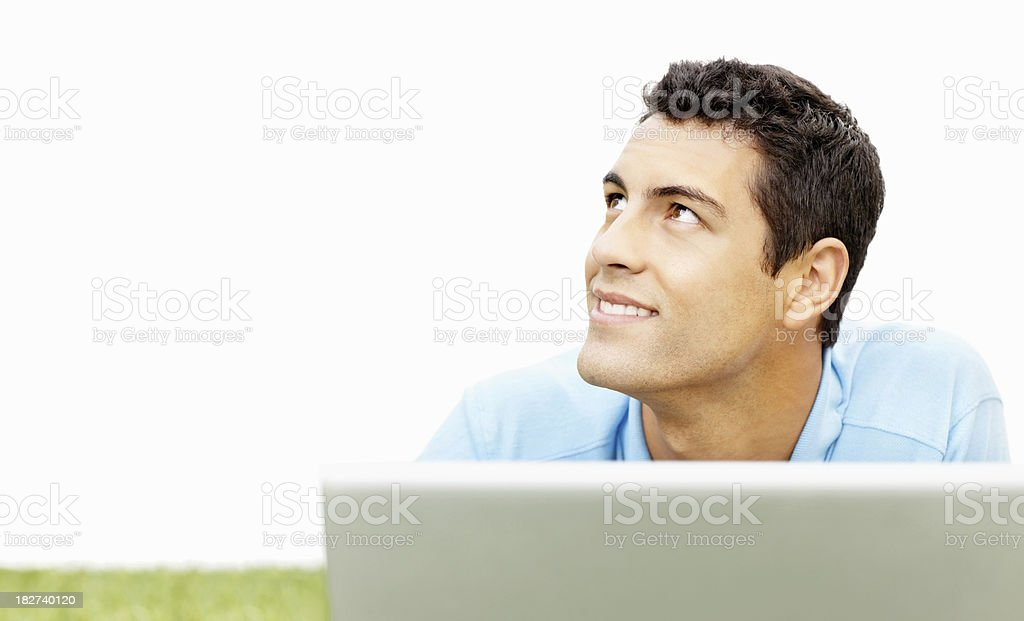 Smiling young man using a laptop and looking at copyspace royalty-free stock photo