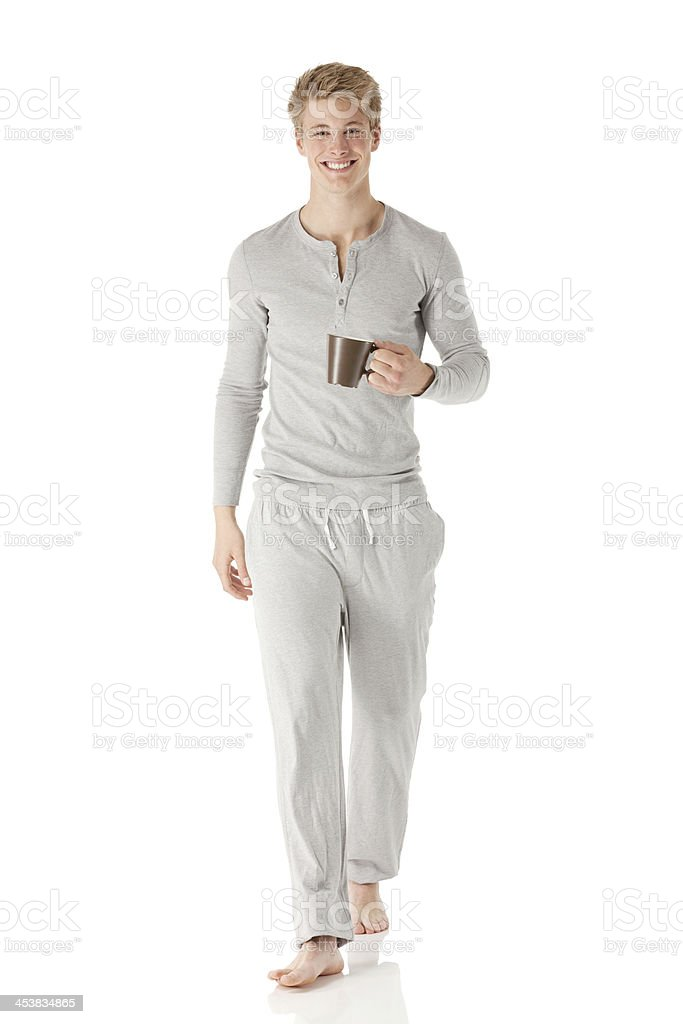 Smiling young man with a cup of coffee royalty-free stock photo