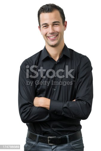 happy young adult with arms crossed looking at camera - isolated on white including path
