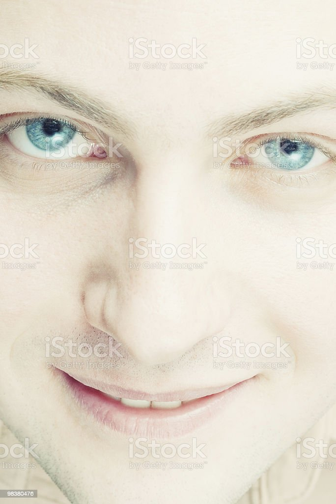 smiling young man with blue eyes royalty-free stock photo