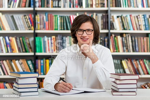 500129038istockphoto smiling young man with dark hair 499099564
