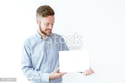 istock Smiling young manager demonstrating advertisement 811285712