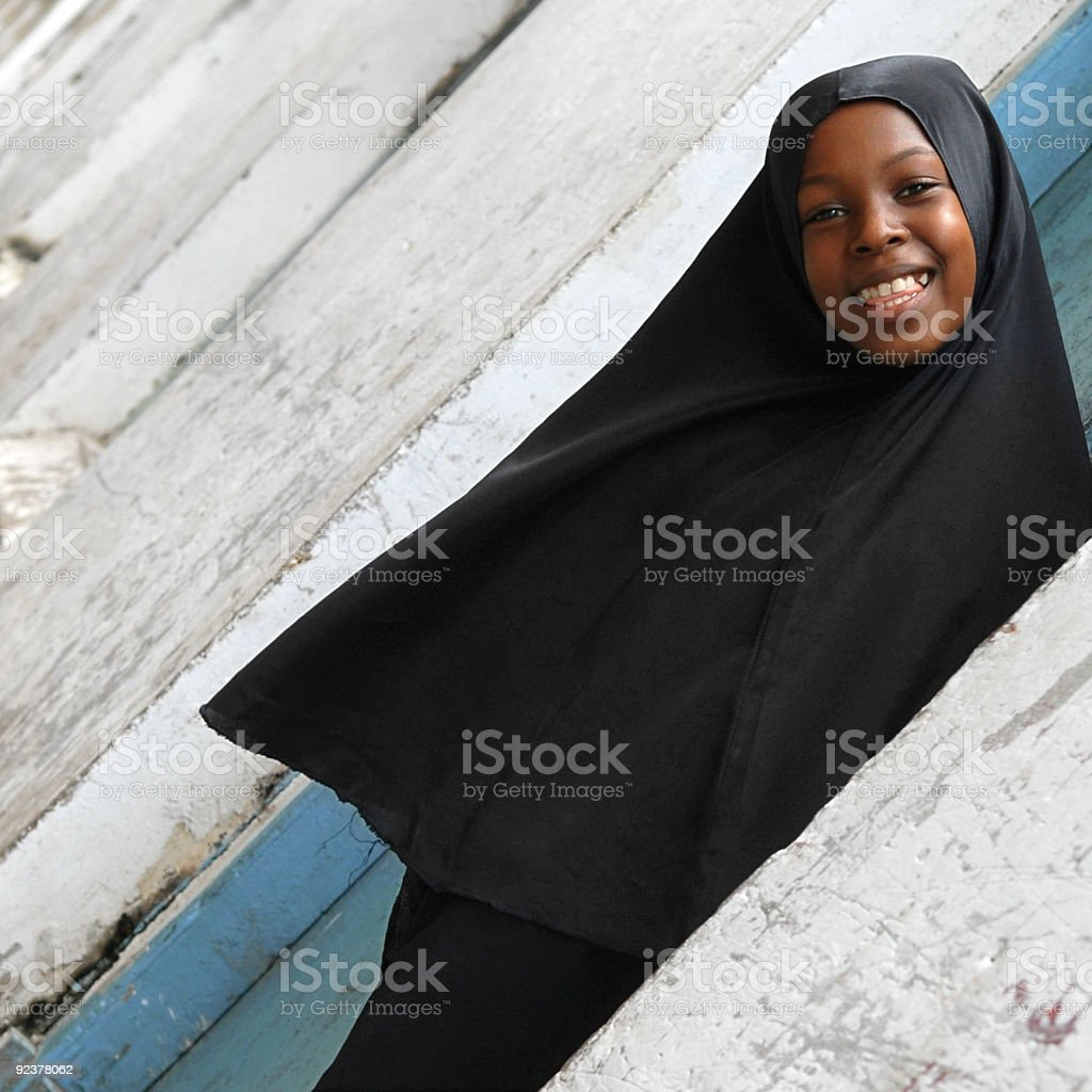 smiling young muslim woman wearing a hijab royalty-free stock photo