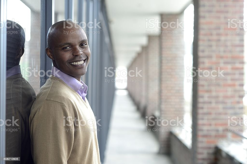 Smiling young office worker outside landscape stock photo