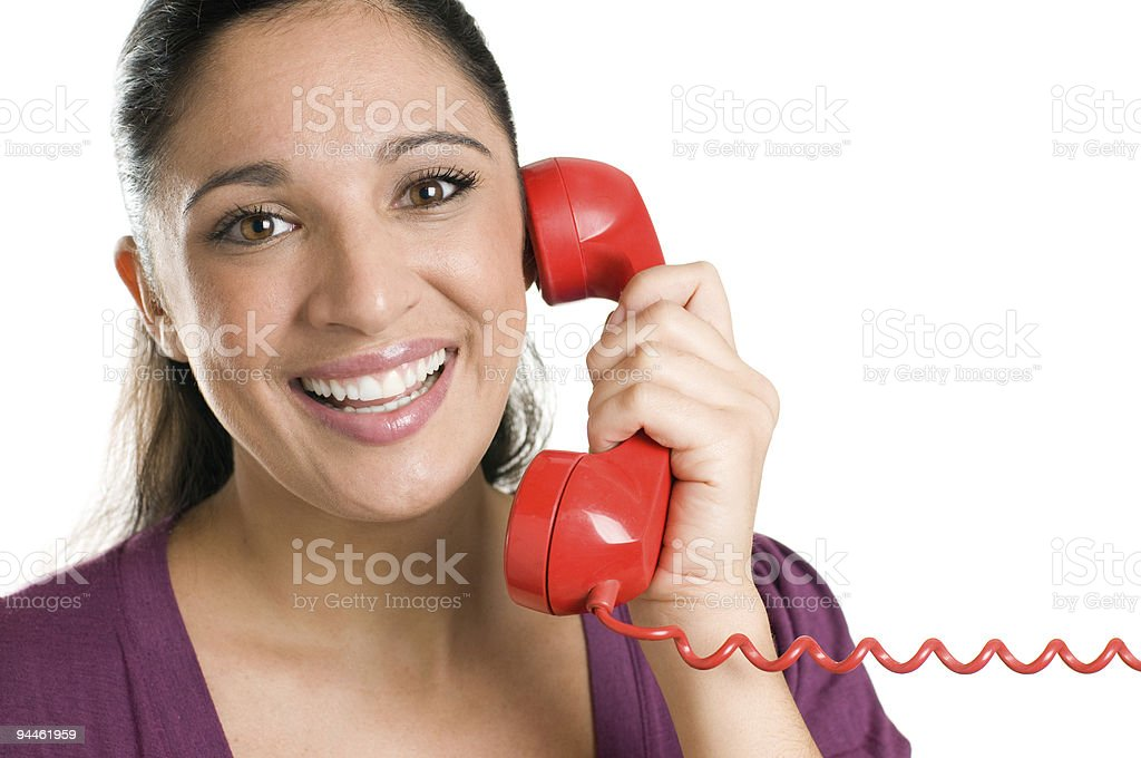 Smiling young operator with red phone royalty-free stock photo