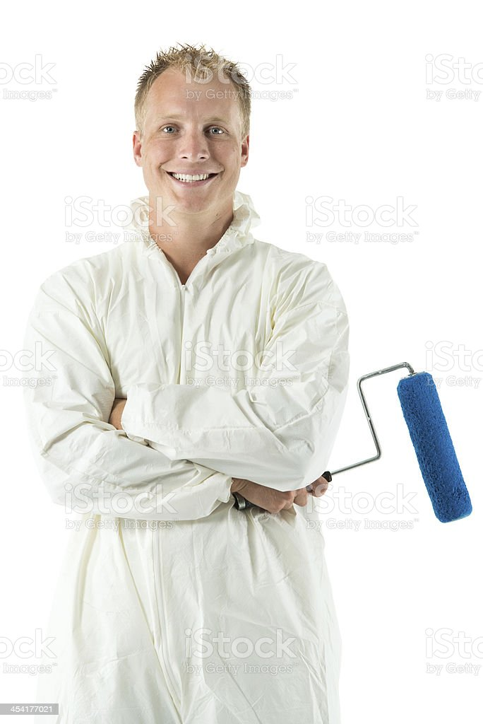 Smiling young painter with paint roller stock photo