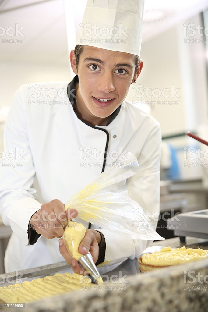 Smiling young pastry cook at school royalty-free stock photo