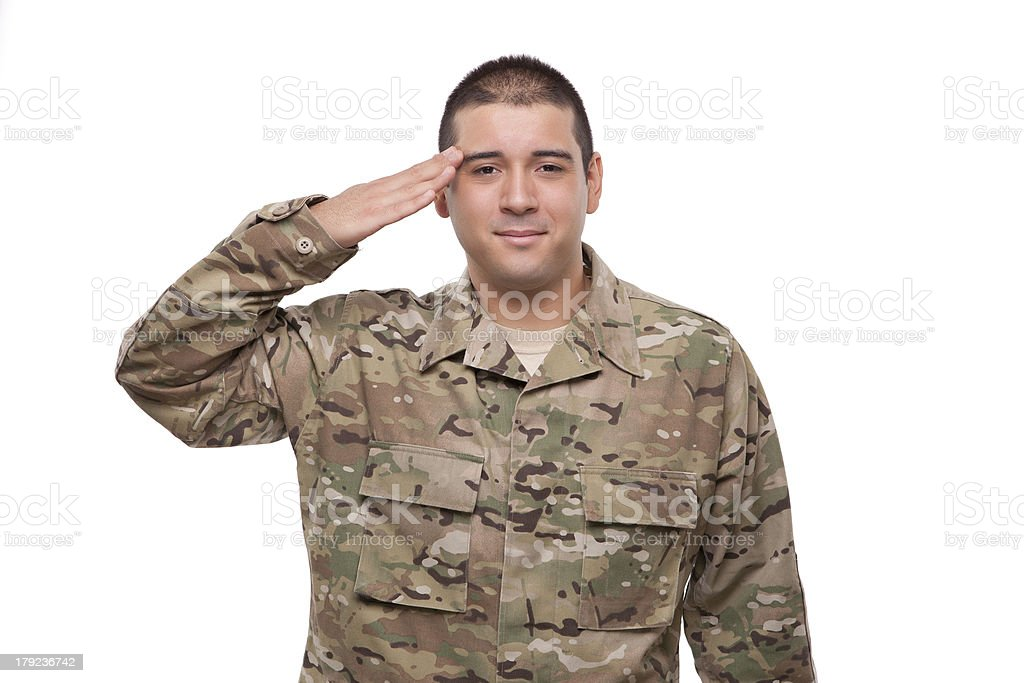Smiling young soldier saluting royalty-free stock photo
