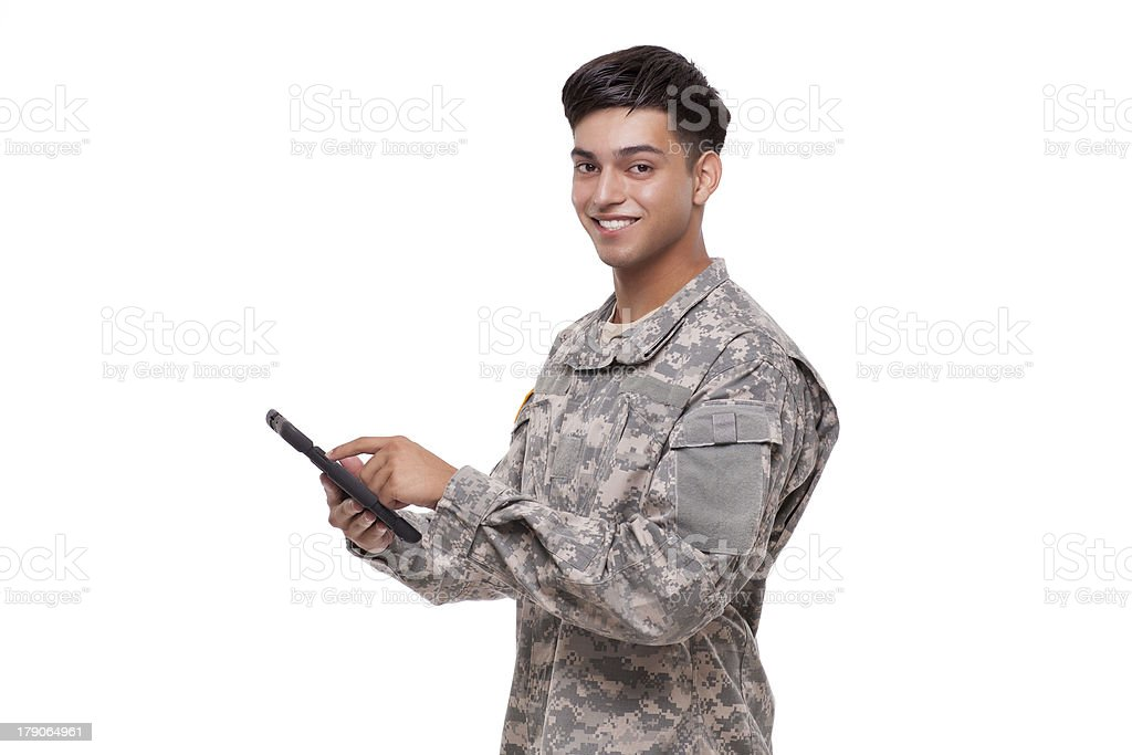 Smiling young soldier with a digital tablet stock photo
