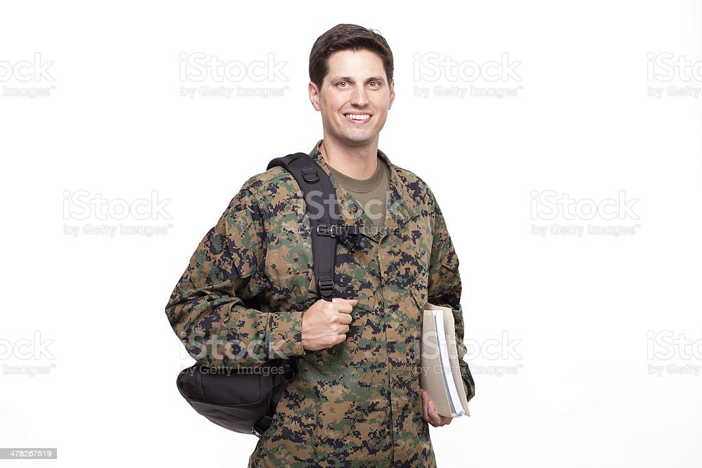 Smiling young soldier with documents and backpack royalty-free stock photo