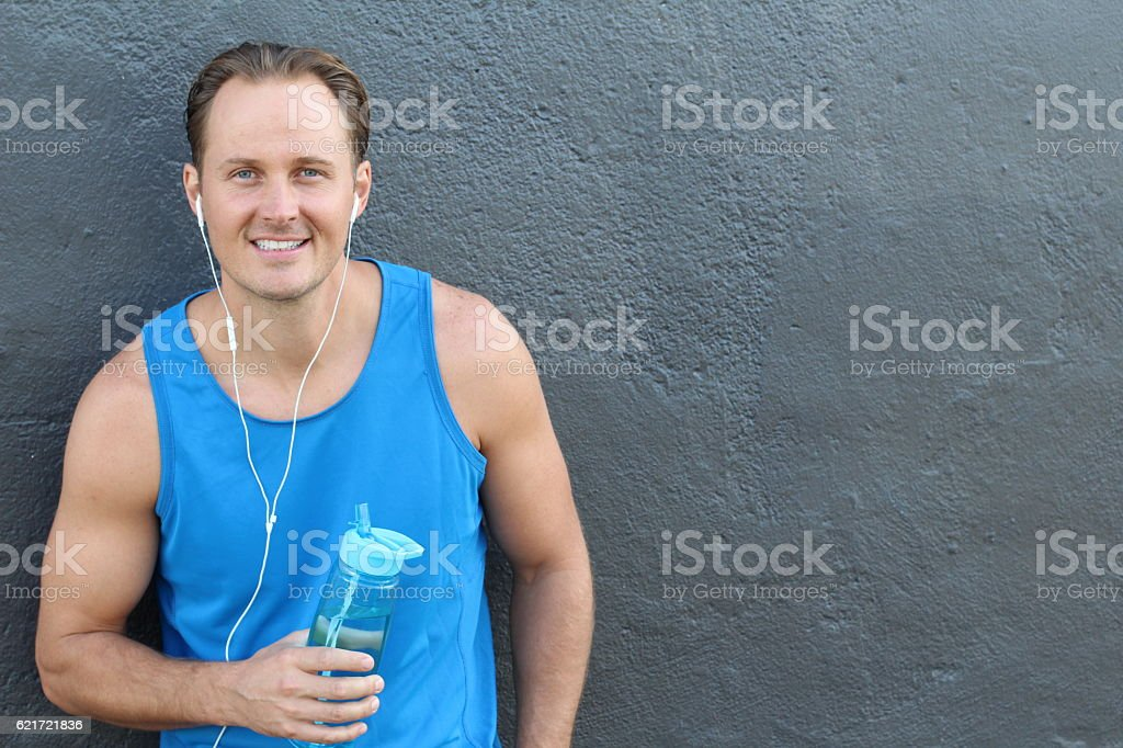 Smiling young strong man isolated stock photo