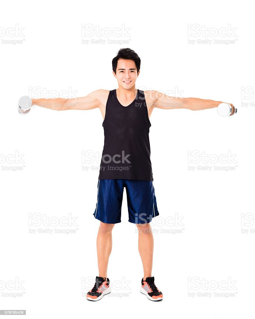 smiling young Strong man with dumbbells stock photo