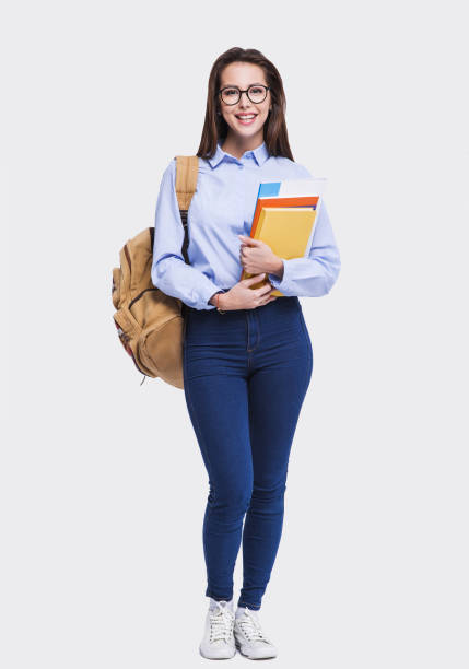 Smiling young student girl full length stock photo