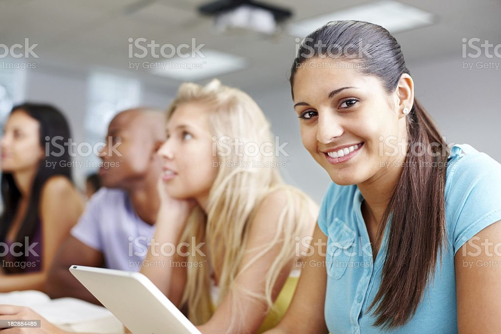 Smiling young student with friends in the background royalty-free stock photo