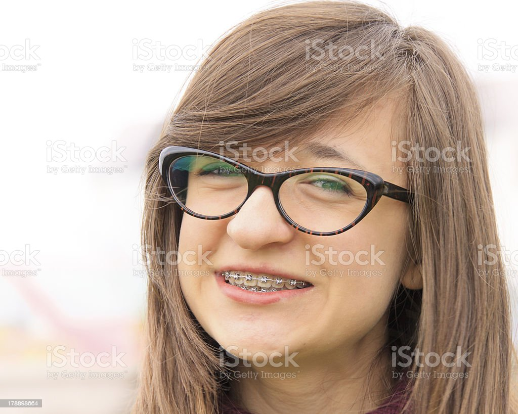 Smiling young teenager with braces stock photo