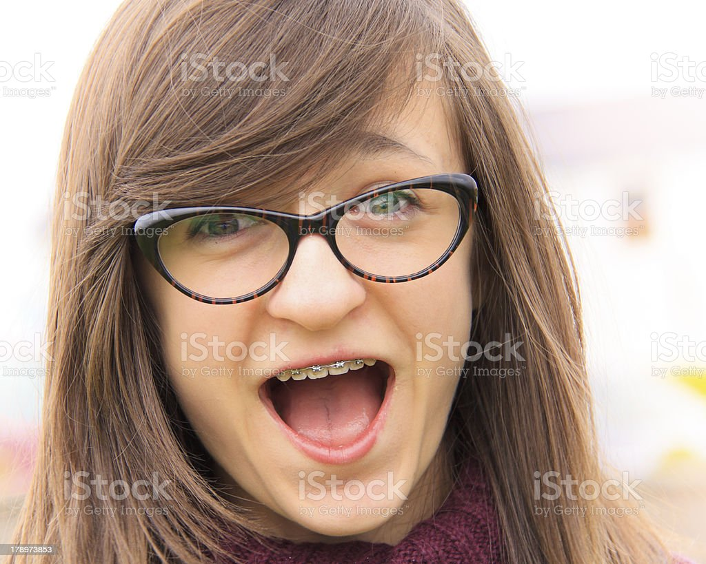 Smiling young teenager with braces royalty-free stock photo