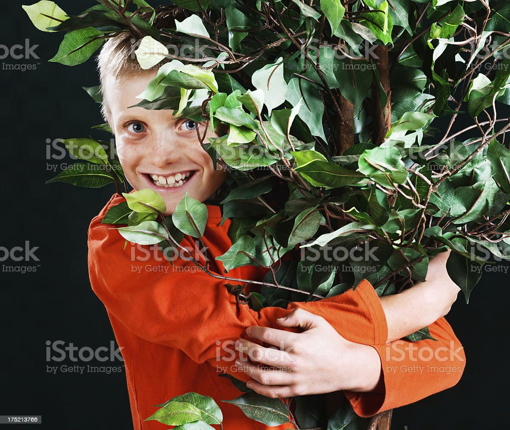 Smiling young tree hugger is environmentally aware royalty-free stock photo