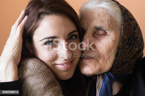 144362548istockphoto Smiling young woman and grandmother embracing 636399810