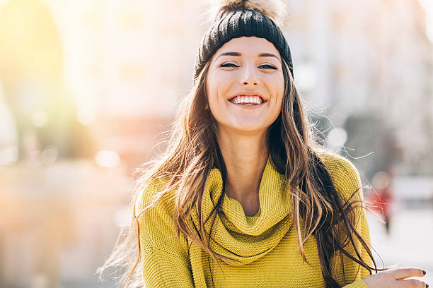 Smiling young woman at sunlight stock photo