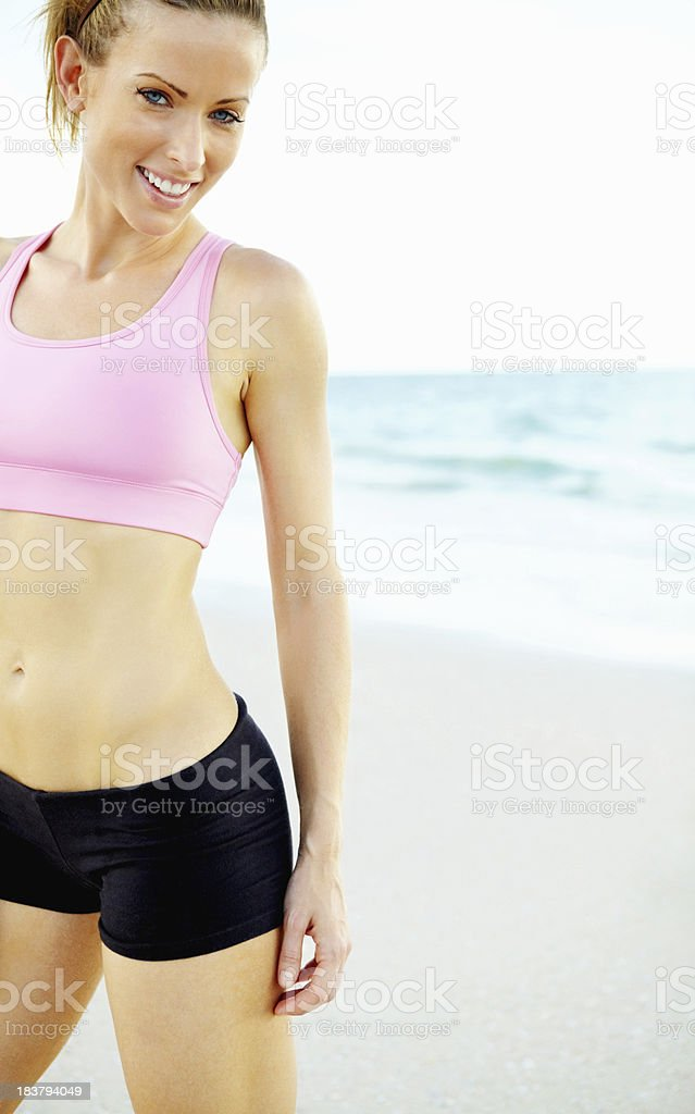 Smiling young woman at the beach royalty-free stock photo