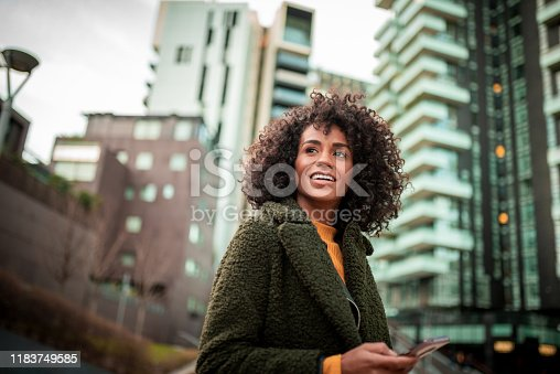 Smiling young woman waiting for her friend