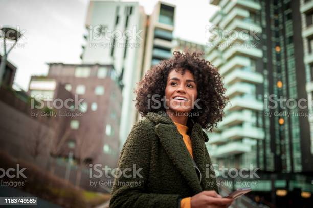 A Smiling Young Woman At The Downtown District Stock Photo - Download Image Now