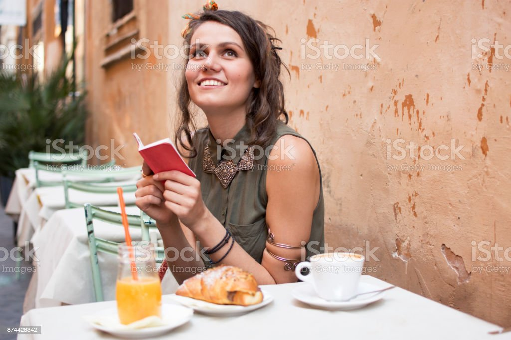 Smiling young woman early in the morning stock photo