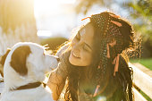 istock Smiling Young Woman Embracing a Dog 954134736