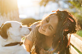 istock Smiling Young Woman Embracing a Dog 954134752
