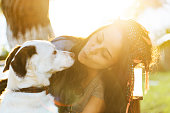 istock Smiling Young Woman Embracing a Dog 954134754