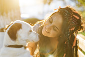istock Smiling Young Woman Embracing a Dog 954134768