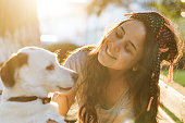 istock Smiling Young Woman Embracing a Dog 954134784
